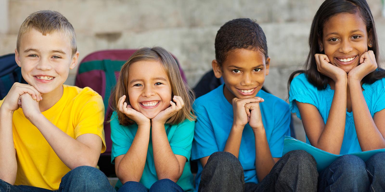 four kids sitting